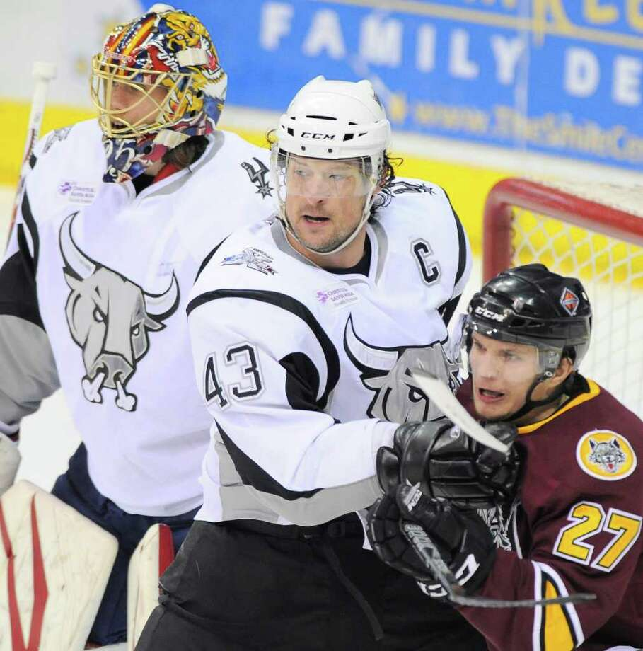 San Antonio Rampage's Nolan Yonkman (43) defends the crease against Chicago Wolves' Antoine Roussel (27) in front of Rampage goaltender Jacob Markstrom during the first period of an AHL hockey game, Wednesday, April 4, 2012, in San Antonio. Photo: Darren Abate, Darren Abate/pressphotointl.com / Darren Abate/pressphotointl.com