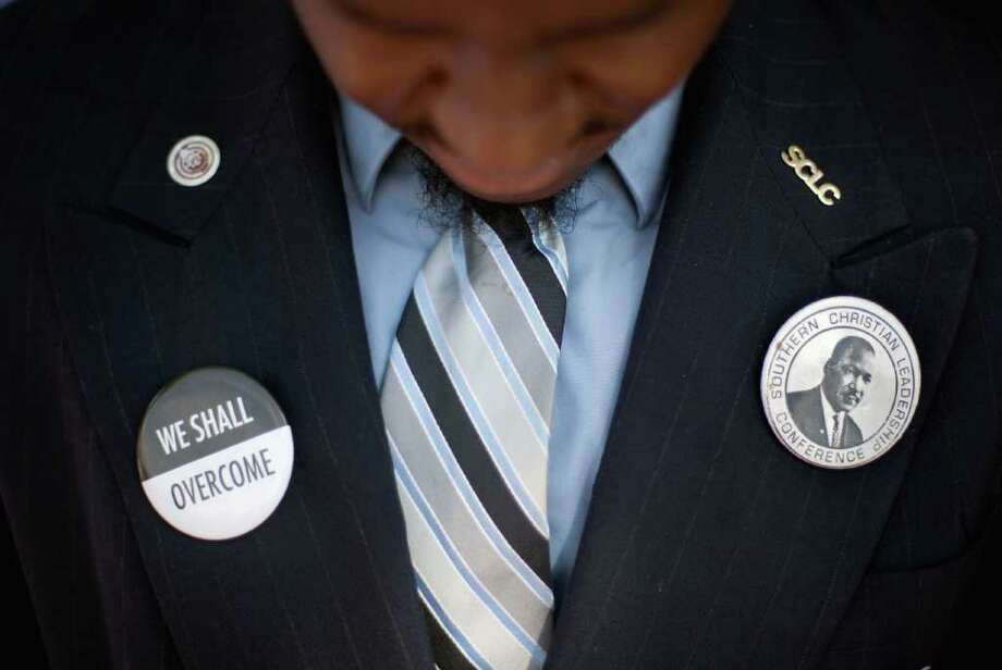 Southern Christian Leadership Conference member Jeremy Ponds bows his head during a moment of prayer at the gravesite of Rev. Martin Luther King Jr., marking the 44th anniversary of his assassination, Wednesday, April 4, 2012, in Atlanta. Photo: David Goldman, Associated Press / AP