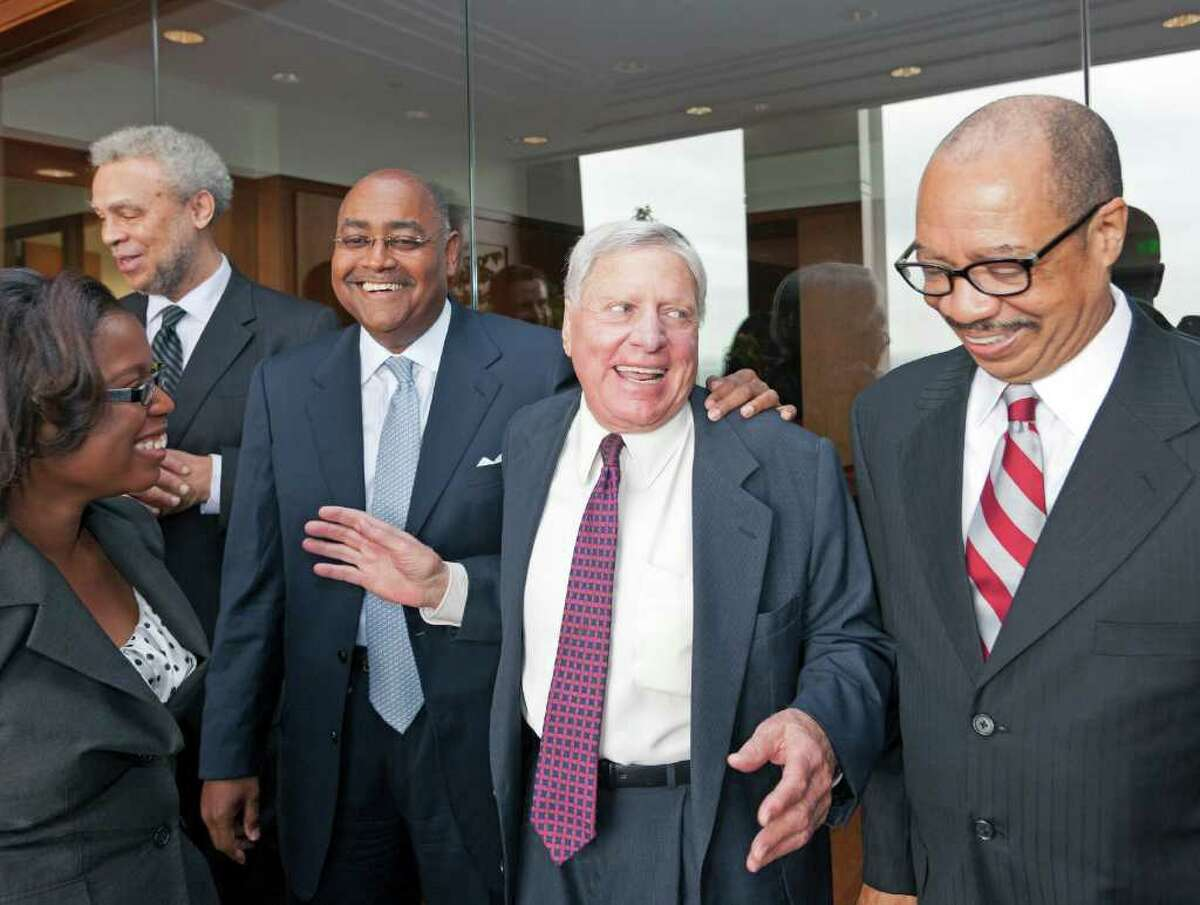 Attorney Joe Jamail, second from right, regales students and faculty from TSU with stories from a lifetime as a legendary trial attorney on April 4, 2012. Pictured, from left, are Whitney White, Dr. Dannye Holley, Dean; Senator Rodney Ellis, Joe Jamail and Dr. John M. Rudley.