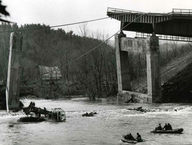 Divers search for bodies in the Schoharie Creek April 9, 1987, four days after a Thruway bridge collapsed sending motorist into the flooded creek below. Ten motorists lost their lives. (Fred McKinney / Times Union archive)