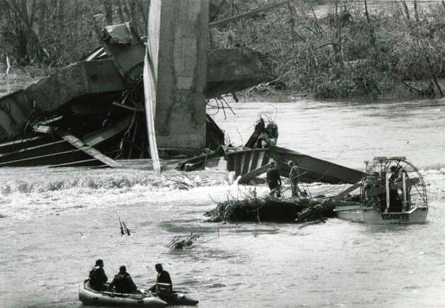 Divers search for bodies in the Schoharie Creek April 9, 1987, four days after a Thruway bridge collapsed sending motorist into the flooded creek below. (Fred McKinney / Times Union archive)