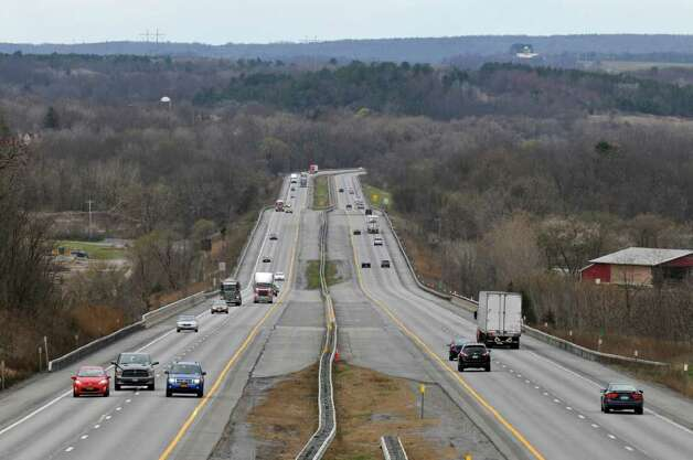 Thruway traffic travels over the bridge that replaced one which collapsed into the Schoharie Creek 25 years ago,  on Wednesday April 4, 2012 in Fort Hunter, NY. The concrete guardrails just above  the foreground mark the area of the bridge.  (Philip Kamrass / Times Union ) Photo: Philip Kamrass / 00017099A