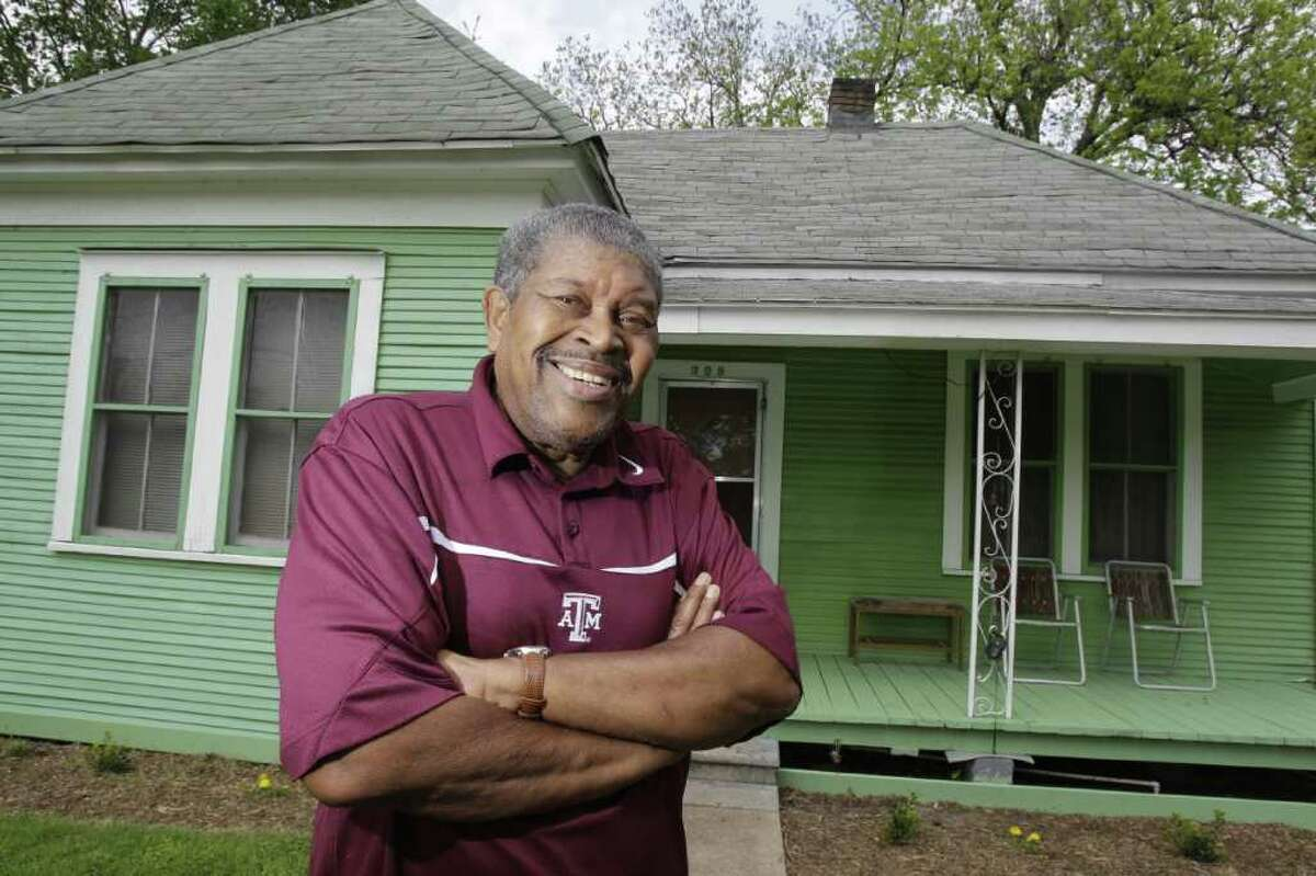Charles Piper, great-grandson of Andrew Carroll, stands in front of his Independence Heights home built circa 1910.