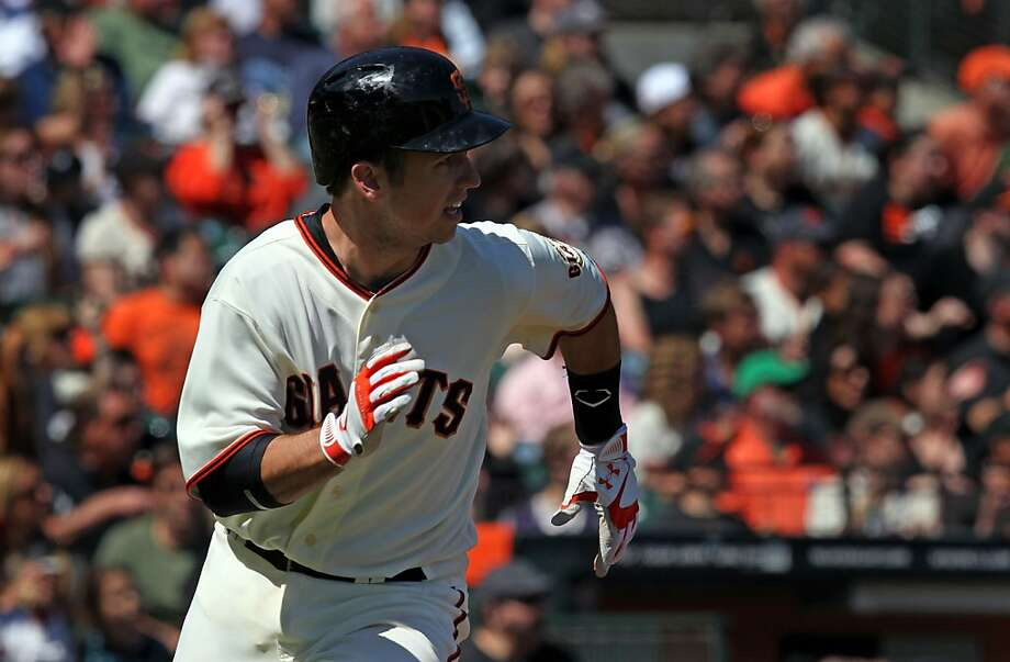 Catcher Buster Posey, hitting a double against the A's, was 2-for-2 in the Giants' final exhibition game. Photo: Lance Iversen, The Chronicle