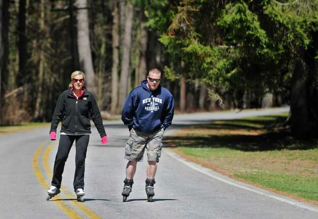 Traci Brown of Clifton Park and her friend Bob Schlegel of Milton rollerblade through Saratoga Spa State Park in Saratoga Springs, N.Y. on Friday April 15, 2011. (Lori Van Buren / Times Union) Photo: Lori Van Buren