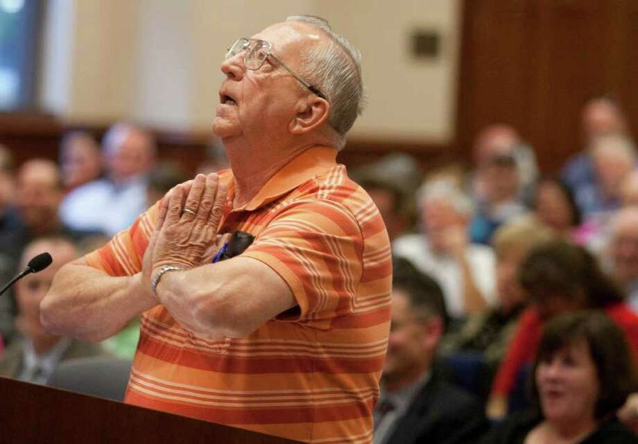 At the Sugar Land City Council, resident Ron Meisinger speaks out against a developer's proposal. Photo: J. Patric Schneider / Houston Chronicle