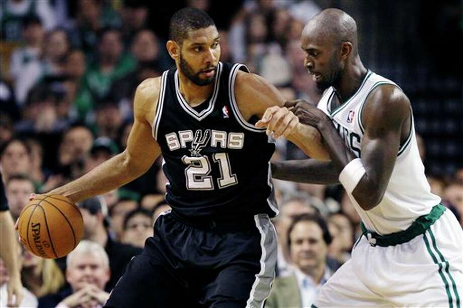 San Antonio Spurs center Tim Duncan (21) makes a move against Boston Celtics forward Kevin Garnett (5) during the second half of an NBA basketball game in Boston, Wednesday, April 4, 2012. The Spurs won 87-86. (AP Photo/Elise Amendola) (AP)