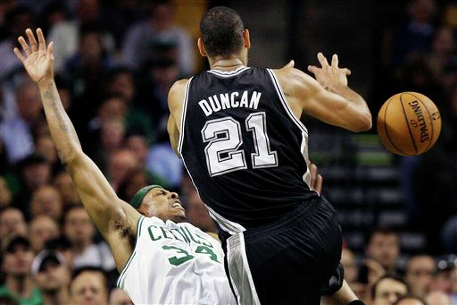 Boston Celtics forward Paul Pierce (34) falls back as he is called for a foul against San Antonio Spurs center Tim Duncan (21) during the second half of an NBA basketball game in Boston, Wednesday, April 4, 2012. The Spurs won 87-86. (AP Photo/Elise Amendola) (AP)