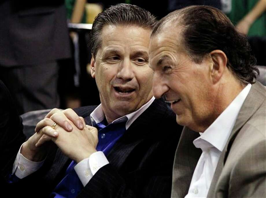 Kentucky basketball head coach John Calipari, left, chats with former Massachusetts treasurer Joe Malone prior to an NBA basketball game between the Boston Celtics and the San Antonio Spurs in Boston, Wednesday, April 4, 2012. (AP Photo/Elise Amendola) (AP)