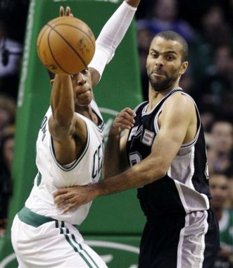 Boston Celtics guard Rajon Rondo, left, loses control of the ball against San Antonio Spurs guard Tony Parker, right, during the first half of an NBA basketball game in Boston, Wednesday, April 4, 2012. (AP Photo/Elise Amendola) (AP)