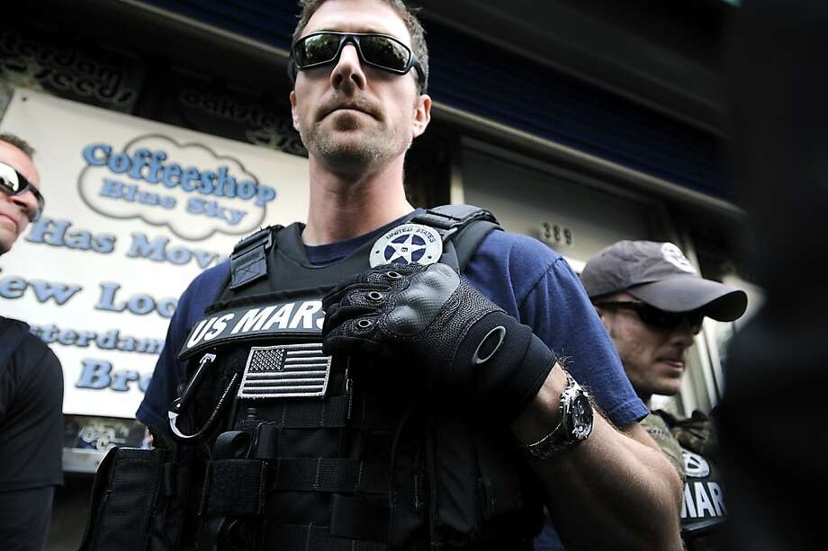 Federal Marshals arrive at Blue Sky Coffeeshop as back up for the agents inside.  Medical Marijuana supporters protested the federal raids on Oaksterdam University in Oakland CA Monday March 2nd, 2012 Photo: Michael Short, Special To The Chronicle