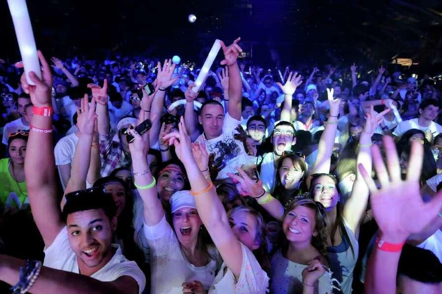 Electronic Music fans dance to the music during the Winter White Tour headlining David Guetta on Thu