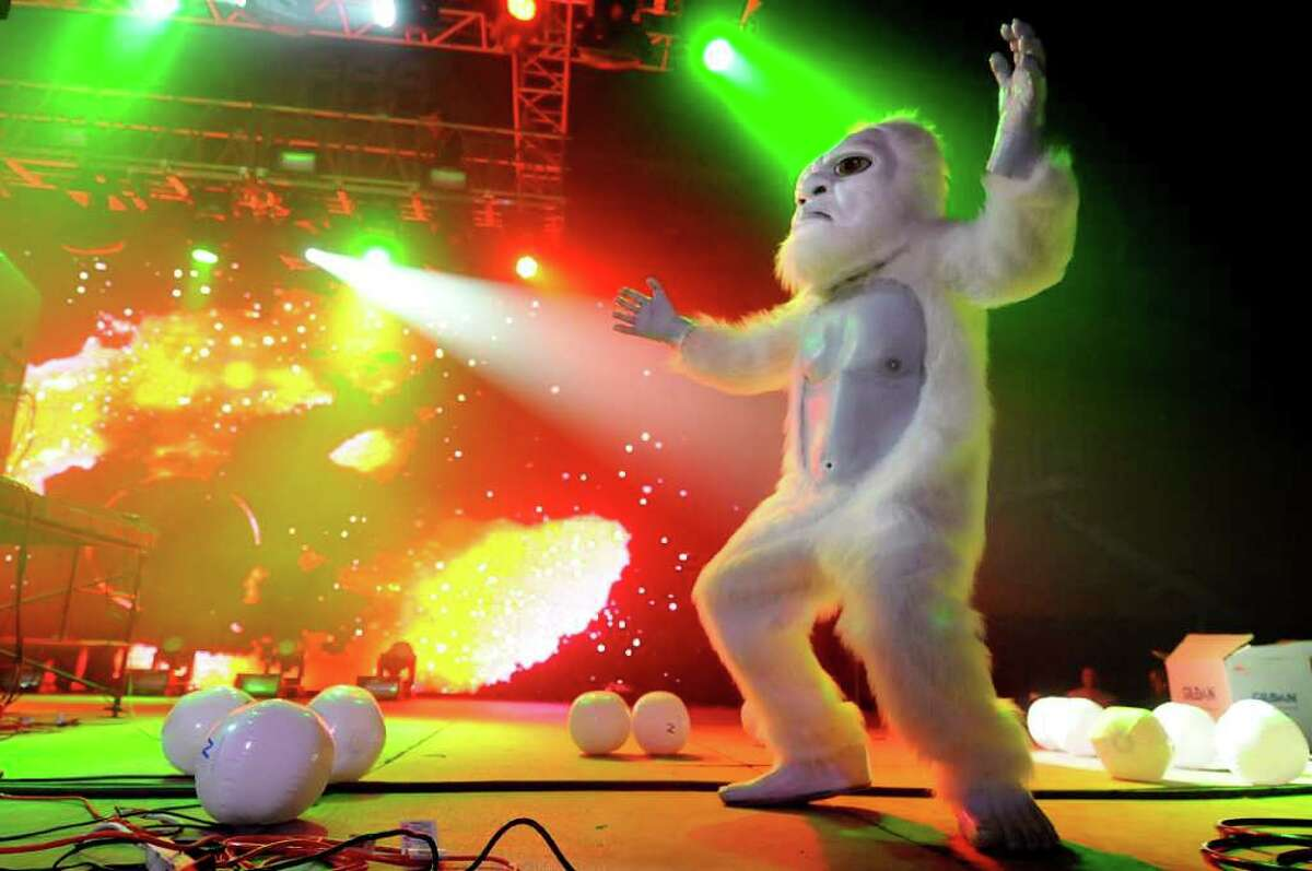 A white gorilla dances to the electronic music on stage during the Winter White Tour on Thursday, Feb. 2, 2012, at the Washington Avenue Armory in Albany, N.Y. (Cindy Schultz / Times Union)