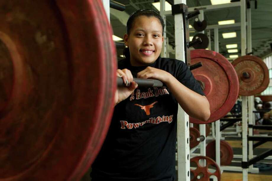 Dobie High School senior Dorthy Tran has parlayed her ability to lift large amounts of weight into a scholarship at the University of Houston-Downtown, where she will join the school's club team. Photo: Brett Coomer / © 2012 Houston Chronicle