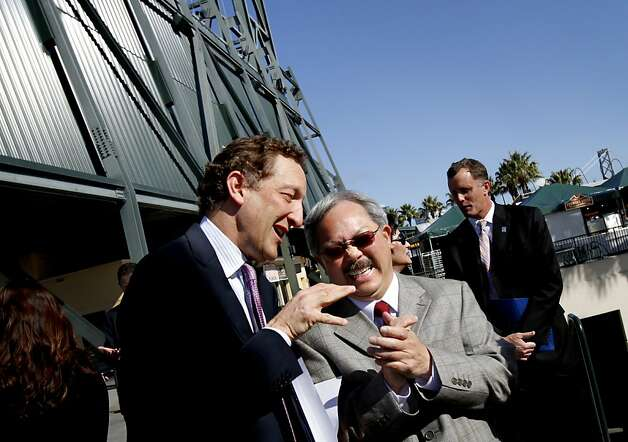 Giant's CEO Larry Baer, left, and Mayor Ed Lee share a laugh before a press conference announcing the Giants' plan to turn their parking lot into a mixed use development with parks, stores, offices, and restaurants in San Francisco, Calif., Wednesday, April 4, 2012. Photo: Sarah Rice, Special To The Chronicle