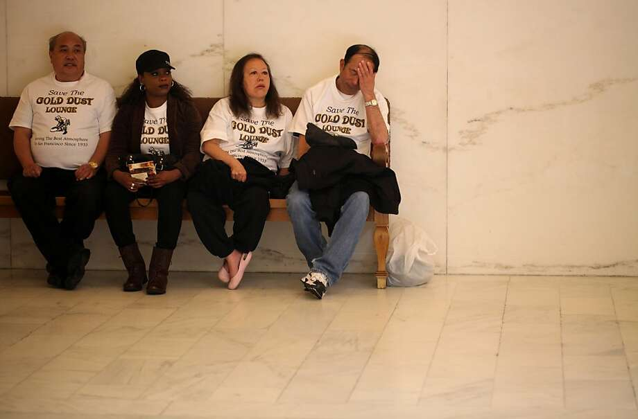 Gold Dust Lounge patrons, Ron Lee, Stephanie Bayang, Suzie Lee and David Wong, wait outside room 400 in City Hall before the Historic Preservation Commission gave its ruling to not grant the Gold Dust Lounge historic landmark status on Wednesday April 4, 2012 in San Francisco, Calif. Photo: Mike Kepka