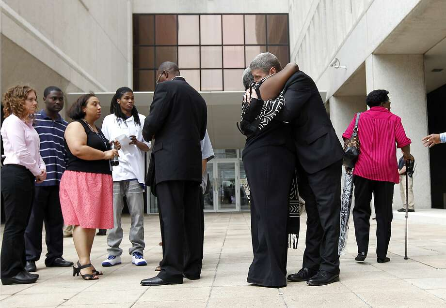 U.S. Attorney Jim Letten hugs a supporter of victims who were shot by New Orleans police, outside Federal Court after sentences were handed down in the case in New Orleans, Wednesday, April 4, 2012. Five former New Orleans police officers were sentenced Wednesday to prison terms ranging from six to 65 years for their roles in deadly shootings of unarmed residents in the chaotic days after Hurricane Katrina. Photo: Gerald Herbert, Associated Press