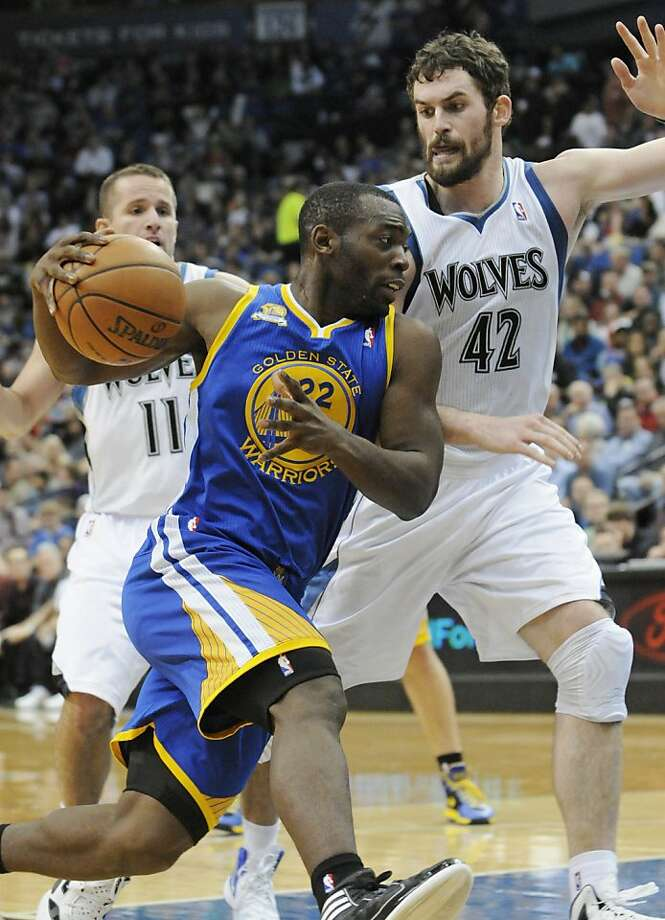 Golden State Warriors' Charles Jenkins (22) drives by Minnesota Timberwolves' Kevin Love, right, in the second half of an NBA basketball game, Wednesday, April 4, 2012, in Minneapolis. The Warriors won 97-94. Photo: Jim Mone, Associated Press