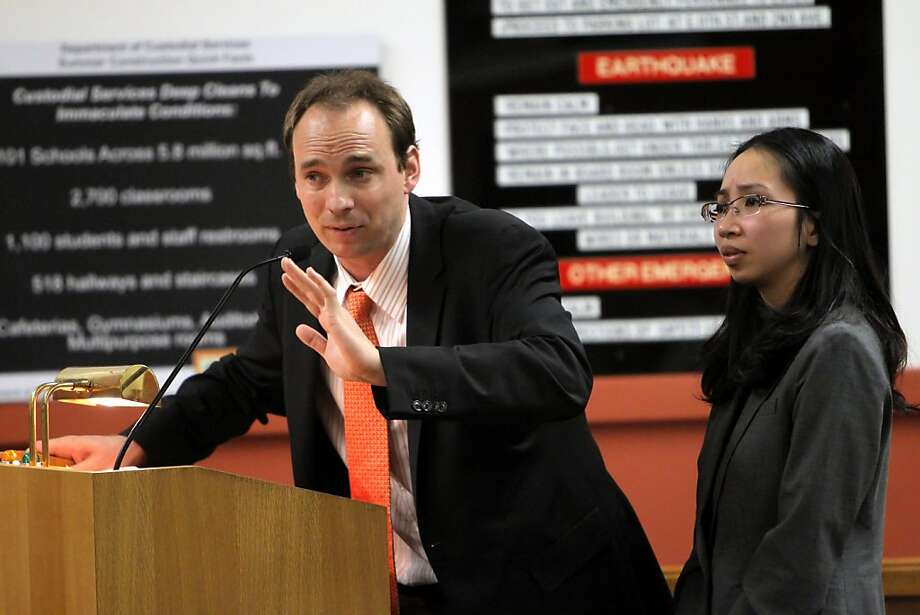 Michael Stember, left, and Christina Chen, right, speak on behalf of the American Indian Public Charter School Board as the Oakland Unified School District Board debates the fate of the school on Wednesday, April 4, 2012, in Oakland, Calif. The school's leadership is accused of mismanaging funds. Photo: Carlos Avila Gonzalez, The Chronicle