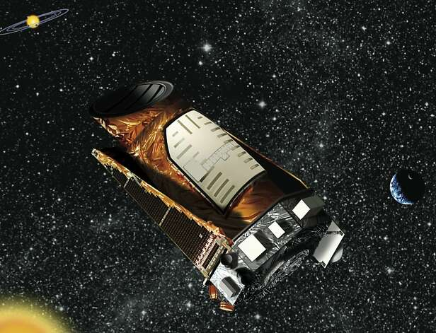 Artist rendering of NASA's Kepler. The mission will spend three and a half years surveying more than 100,000 sun-like stars in the Cygnus-Lyra region of our Milky Way galaxy. It is expected to find hundreds of planets the size of Earth and larger at various distances from their stars. If Earth-size planets are common in the habitable zone, Kepler could find dozens; if those planets are rare, Kepler might find none. Photo: David Koch, NASA