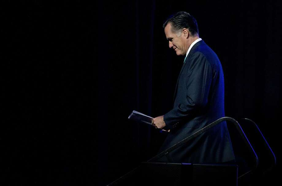 Republican presidential candidate, former Massachusetts Gov. Mitt Romney leaves after speaking at the Newspapers Association of America/ American Society of News Editors luncheon gathering in Washington, Wednesday, April 4, 2012.  (AP Photo/Manuel Balce Ceneta) Photo: Manuel Balce Ceneta, Associated Press
