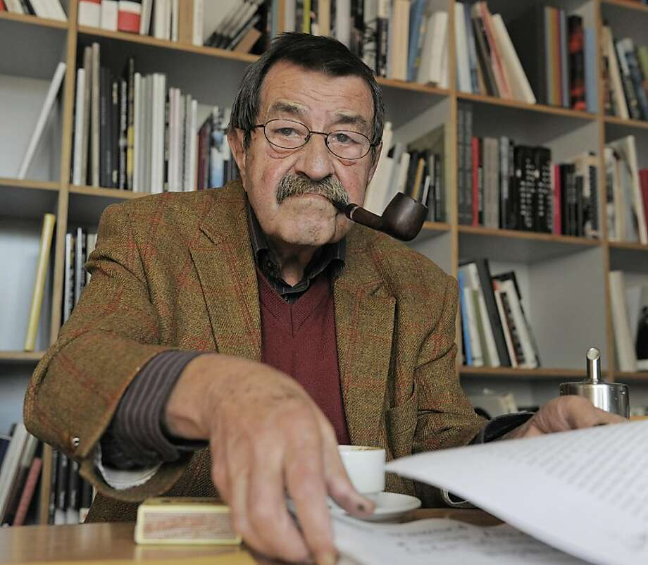 "The Oct. 15, 2009 file photo shows German writer and Nobel price laureate for literature Guenter Grass during an interview with journalists of the Associated Press in the library of Steidl publishers in Goettingen, Germany.  Grass is sharply criticizing Israel amid tensions with Iran and what he describes as Western hypocrisy over Israel's suspected nuclear program. In a prose poem published Wednesday, April 4, 2012 in German daily Sueddeutsche Zeitung, the 84-year-old Grass highlighted Berlin's recent sale to Israel of a submarine able to ""send all-destroying warheads where the existence of a single nuclear bomb is unproven."" Photo: Jens Meyer, Associated Press"