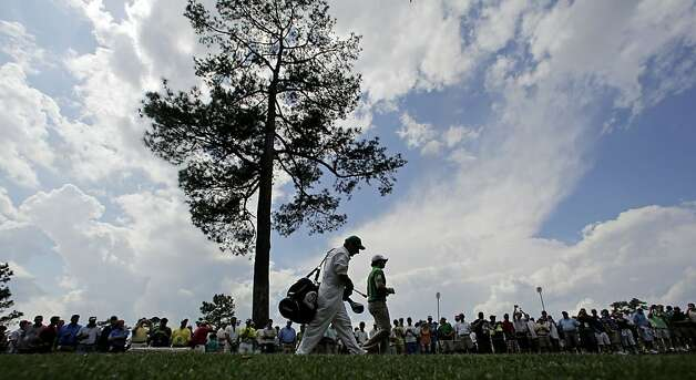 Rory McIlroy, of Northern Ireland, walks down the 18th fairway during a practice round for the Masters golf tournament Wednesday, April 4, 2012, in Augusta, Ga. Photo: Charlie Riedel, Associated Press
