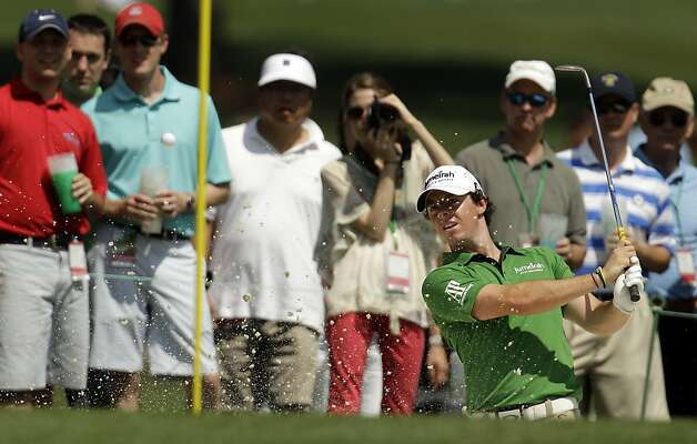 Rory McIlroy, of Northern Ireland, chips out of a bunker on the 15th hole during a practice round at the Masters golf tournament Wednesday, April 4, 2012, in Augusta, Ga. Photo: Charlie Riedel, Associated Press