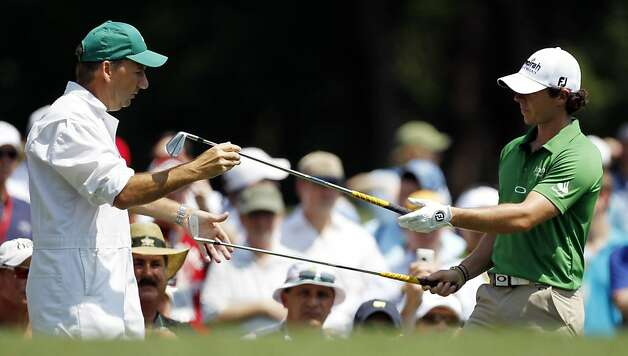 Rory McIlroy, of Northern Ireland, switches clubs with his caddie J.P. Fitzgerald on the 12th hole during a practice round at the Masters golf tournament Wednesday, April 4, 2012, in Augusta, Ga. Photo: Chris O'Meara, Associated Press