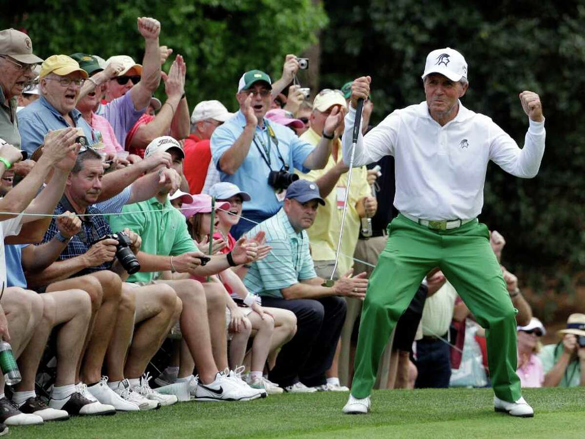 Gary Player reacts after his birdie on the first hole during the par 3 competition at the Masters golf tournament Wednesday, April 4, 2012, in Augusta, Ga.