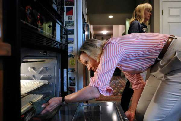 Janie Worth removes freshly baked communion bread from the oven in her home. The bread will be used at Presbyterian Church. Tuesday, March 27, 2012. Billy Calzada / San Antonio Express-News