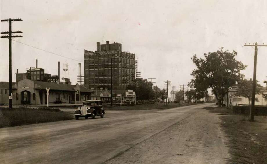 This photo from the summer of 1934 shows the view looking down U.S. 90A in front of the Imperial Sugar refinery in Sugar Land. Photo: Houston Chronicle / Houston Chronicle