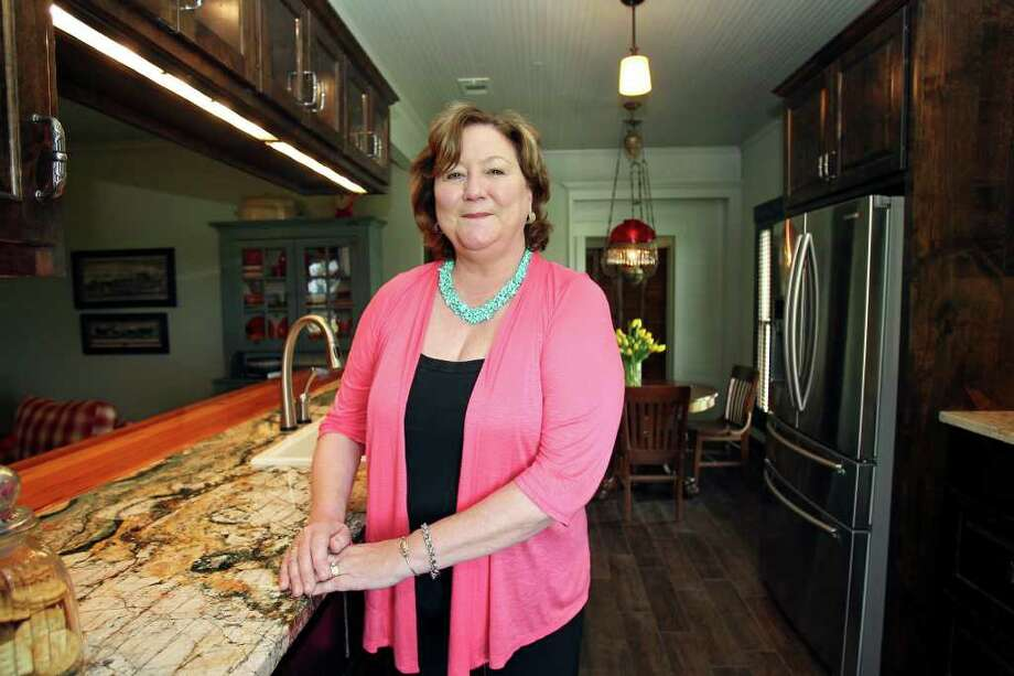 Chrissy Koenig and husband Jim inherited their century-old Seguin farmhouse from friends and spent two years restoring and remodeling it. The kitchen retains its original footprint. Photo: TOM REEL, San Antonio Express-News / San Antonio Express-News