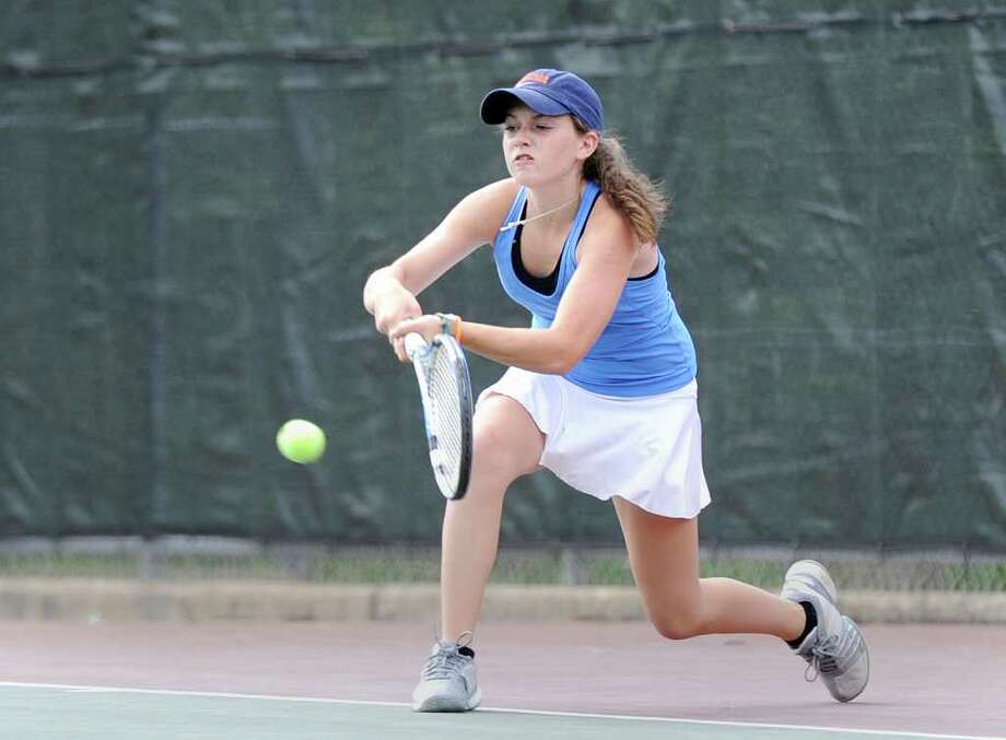 Jenna Murray of Darien High School in action against Sam Stone of Greenwich High School during girls high school tennis match between Darien High School and Greenwich High School at Greenwich High School, Tuesday afternoon, May 10, 2011. Photo: Bob Luckey, ST / Greenwich Time