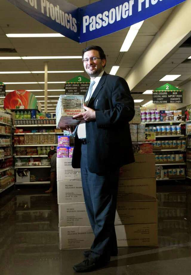 Rabbi Aryeh Wolbe holds a box of Holyland Matzos at the Kroger in Meyerland Wednesday, March 28, 2012, in Houston. The Kroger contains Kosher foods for Passover, when many  Jews adopt stricter diets and refrain from eating foods with leavening. (Cody Duty / Houston Chronicle) Photo: Cody Duty / © 2011 Houston Chronicle