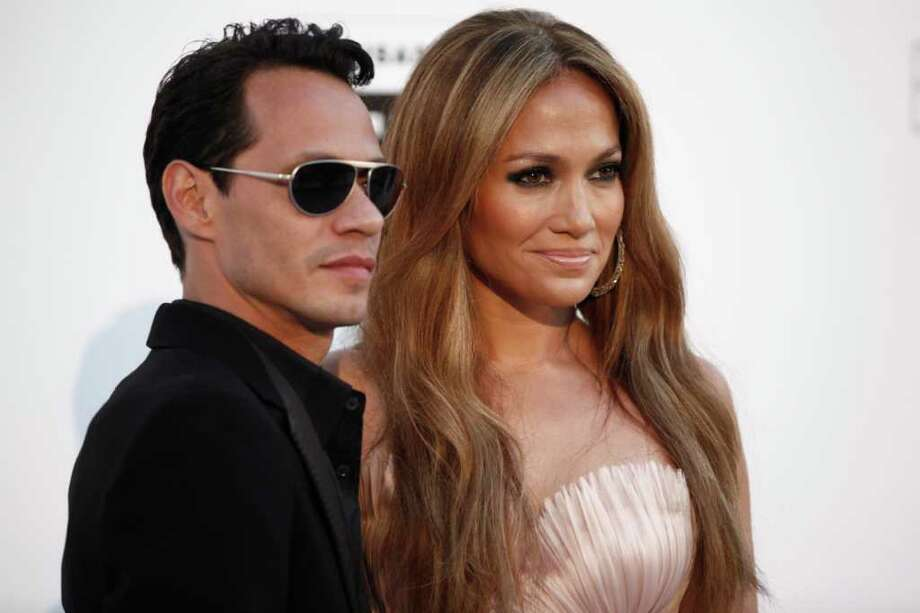 "FILE  - In a May 20, 2010 file photo, singers Marc Anthony and Jennifer Lopez arrive for the amfAR Cinema Against AIDS benefit during the 63rd Cannes international film festival, in Cap d'Antibes, southern France. The exes have announced that they'll perform together on May 26 in Las Vegas as part of ""Q'Viva! The Chosen Live,"" which will feature the top talent from their televised talent show. (AP Photo/Matt Sayles, File) Photo: Matt Sayles, AP / AP2010"