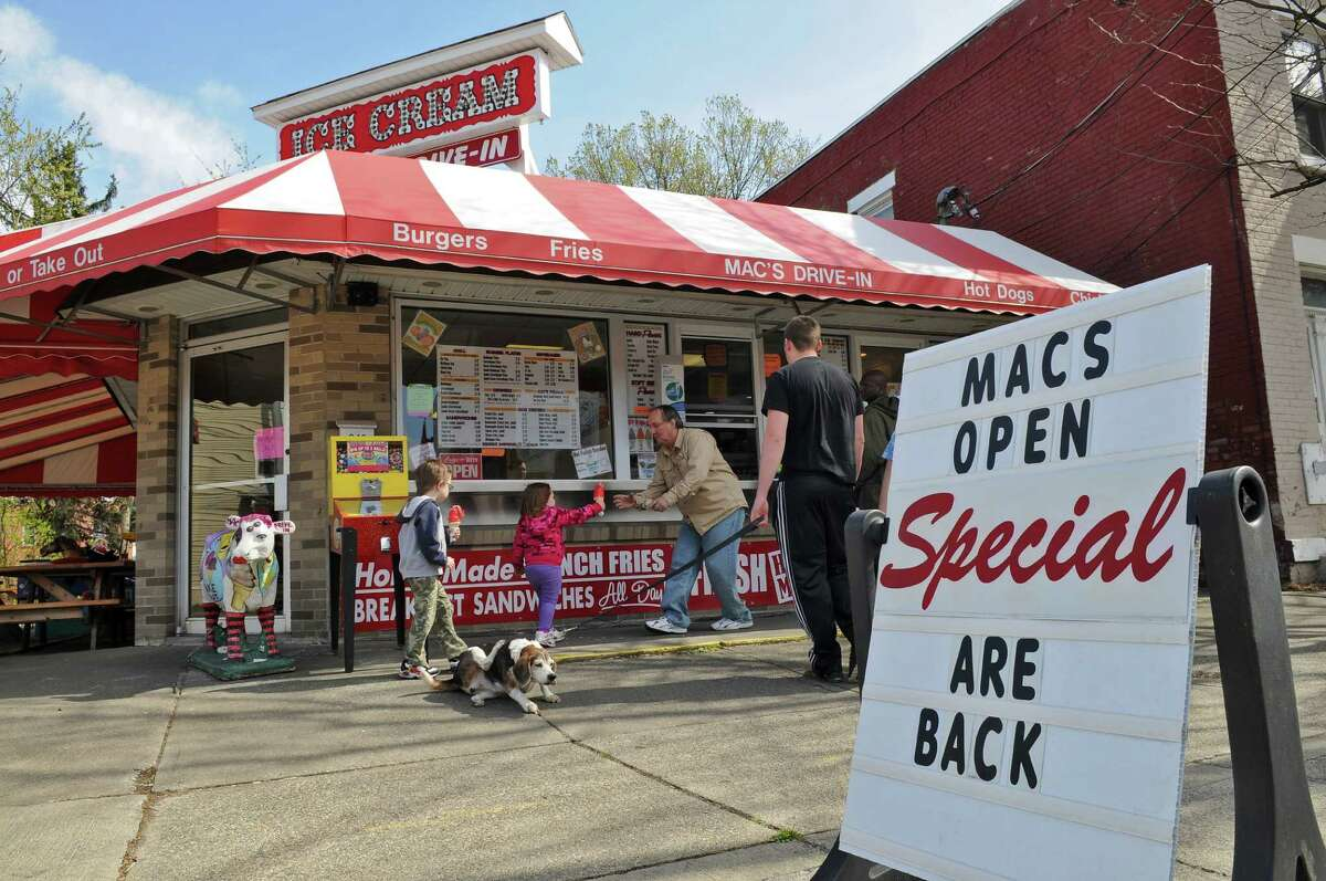 Customers buy ice cream at Mac's Drive-In, on Tuesday April 3, 2012 in Watervliet, NY. (Philip Kamrass / Times Union )