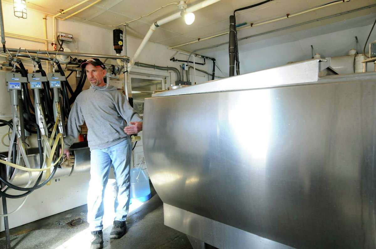 Chuck Curtiss stands by a milk vat on Wednesday, Feb. 22, 2012, at Willow Marsh Farm in Ballston, N.Y. (Cindy Schultz / Times Union)