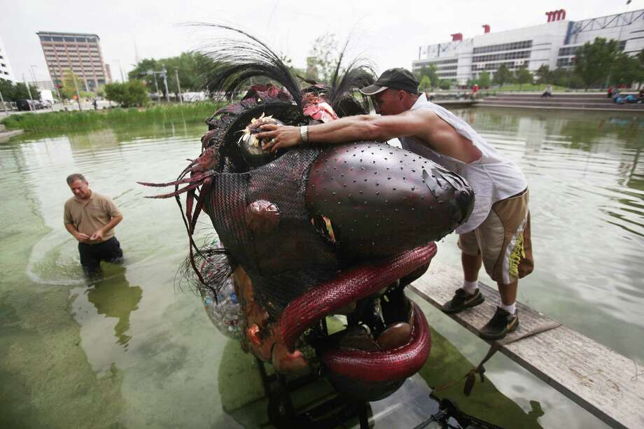 "Eco Artist Mark Bradford assembles ""NOMO"" Trash Fish sculpture before installing it in the lake at Discovery Green on Thursday, April 5, 2012, in Houston. Photo: Mayra Beltran, Houston Chronicle / © 2012 Houston Chronicle"
