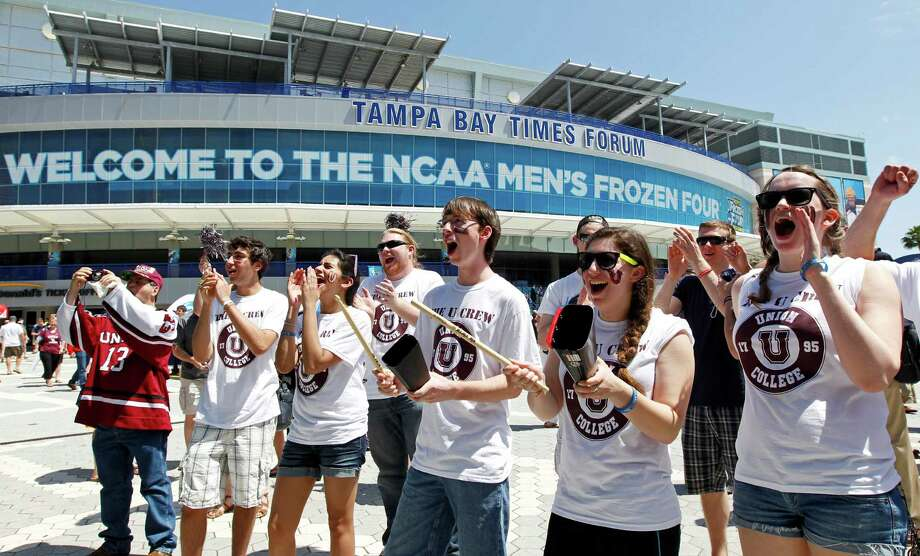 Students from Union College cheer during a pep rally for their school outside the Tampa Bay Times Forum prior to their school's NCAA Frozen Four college hockey tournament semifinal game against Ferris State, Thursday, April 5, 2012, in Tampa, Fla. (AP Photo/Mike Carlson) Photo: MIKE CARLSON