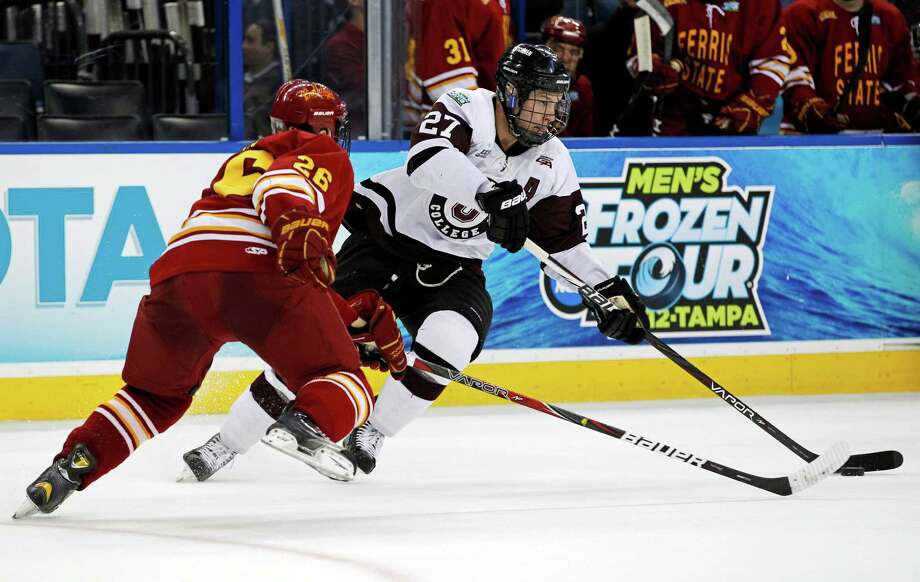 Union College's Jeremy Welsh, right, looks to get past Ferris State's Simon Denis during the first period of an NCAA Frozen Four college hockey tournament semifinal game, Thursday, April 5, 2012, in Tampa, Fla. (AP Photo/Mike Carlson) Photo: MIKE CARLSON