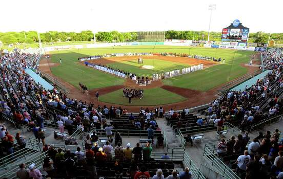 The Wolff Stadium ballpark surface is alive with activity during pre-game ceremonies on opening day for the San Antonio Missions Texas League baseball club on Thursday, April 5, 2012. They played the Tulsa Drillers. Billy Calzada / San Antonio Express-News Photo: BILLY CALZADA, San Antonio Express-News / SAN ANTONIO EXPRESS-NEWS