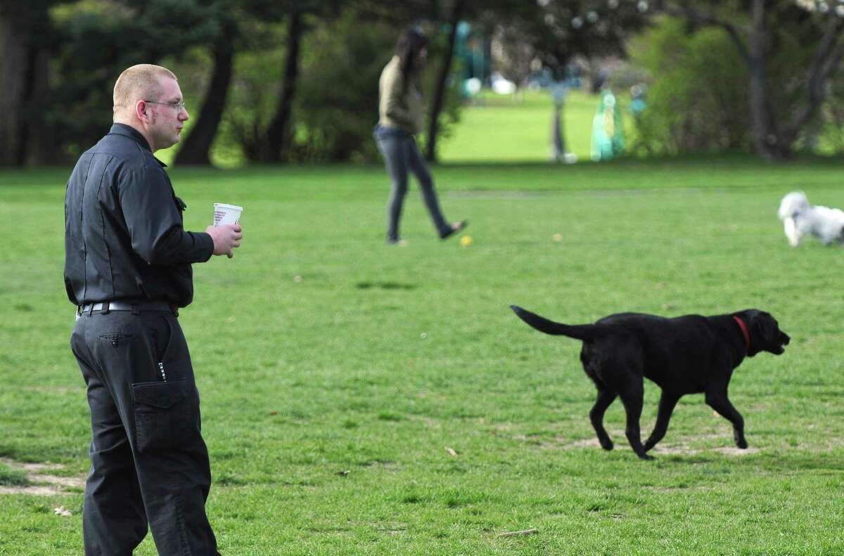 Albany Animal Control officer Jason Hogan visits with dog owners and their pets in Washington Park on Thursday afternoon April 5, 2012 in Albany, NY. (Philip Kamrass / Times Union )