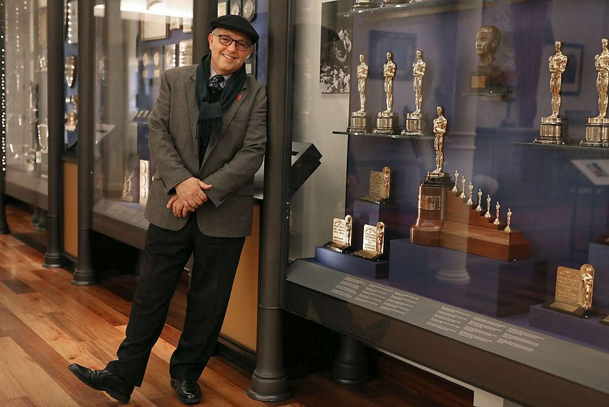 Director of collections Michael Labrie of the Walt Disney Family Museum in the Presidio in San Francisco, Calif., next to the museum's Oscar collection on Tuesday, February 7, 2012.