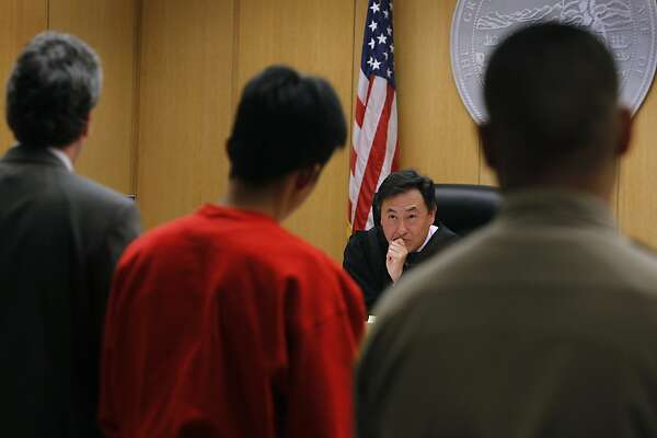 Judge Samuel Feng listens as Binh Thai Luc pleads not guilty to multiple counts of homicide during his arraignment at the Hall of Justice in San Francisco, Calif. on Thursday, April 5, 2012. Luc is accused of murdering five people at a home near City College last month.