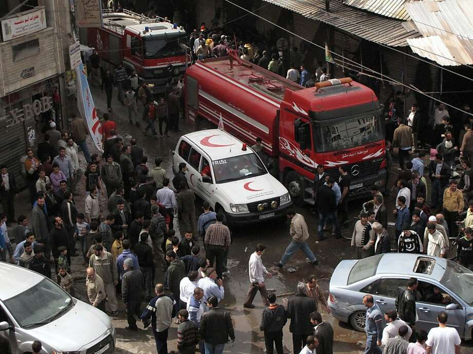 Firefighters and the Syrian Red Crescent enter a neighborhood of Damascus, Syria, after a raid by Syrian troops killed several rebels and civilians Thursday, April 5, 2012. Syrian troops launched a fierce assault Thursday, days ahead of a deadline for a U.N.-brokered cease-fire, with activists describing it as one of the most violent attacks around the capital since the year-old uprising began. Photo: Anonymous, Associated Press