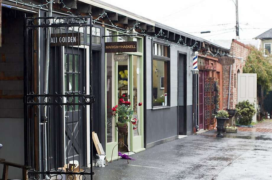 Temescal Alley in Oakland brims with a bohemian vibe as small shops blossom and lure families and hipsters alike to take in their wares from artisan clothing to sweets to handcrafted jewelry. Photo: Stephen Lam, Special To The Chronicle
