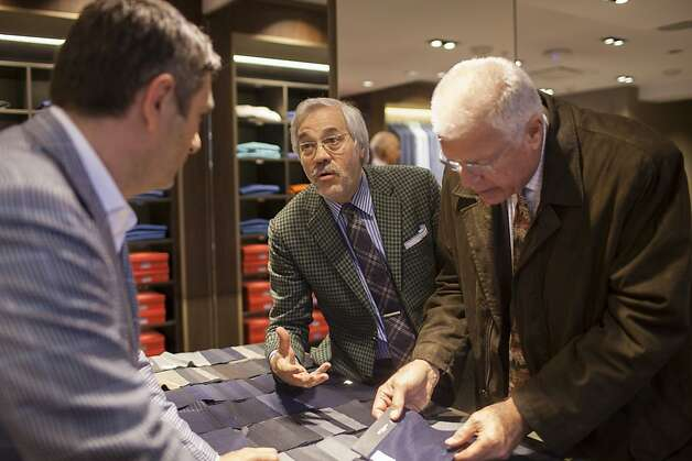 Kiton chairman Massimo Bizzocchi, center, helps customer Peter Rowe, right, of Lafayette, CA, during the Kiton Trunk Show at Wilkes Bashford in San Francisco, Calif. on Saturday, March 24, 2012. Photo: Stephen Lam, Special To The Chronicle