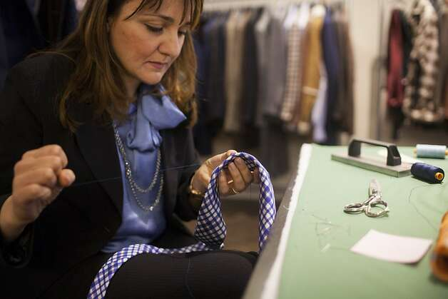 Kiton tie specialist Irma Silvestro, of Italy, prepares to make a tie during the Kiton Trunk Show at Wilkes Bashford in San Francisco, Calif. on Saturday, March 24, 2012. Photo: Stephen Lam, Special To The Chronicle