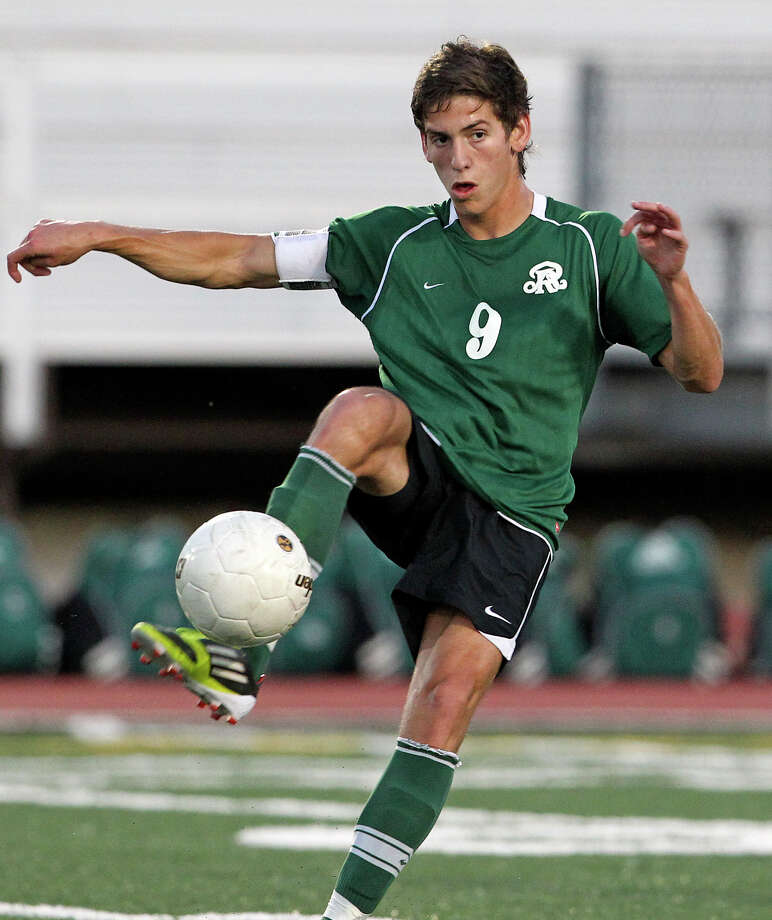 Reagan's Juan Pablo Garza makes a pass for the Rattlers as the Rattlers play the Cougars in boys soccer playoff action at Comalander Stadium on Thursday, April 5, 2012. Photo: TOM REEL, San Antonio Express-News / San Antonio Express-News